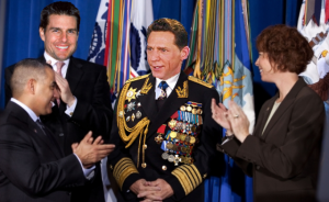The Honorable, the Beneficent, Fleet Admiral David Miscavige is applauded by Sea Org members including Tom Cruise.