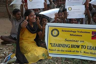 Grimy unwashed foreigners have learned to read thanks to the Church of Scientology!