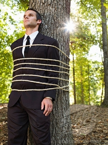 Businessman Tied to Tree in Forest