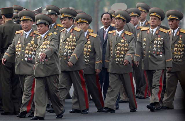 North Korean senior military officials arrive for the opening ceremony of the Cemetery of Fallen Fighters of the KPA in Pyongyang