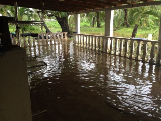 Flooded Front Porch of a Guam Residence